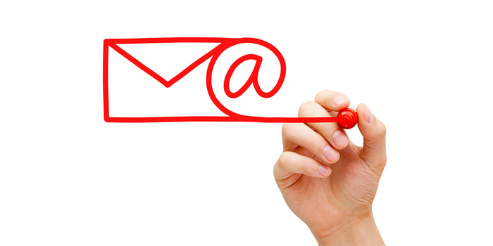 Hand drawing mail and at symbol for email